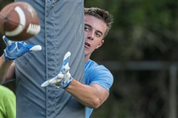 Bishop Canevin wide receiver Alex Shaughnessy makes a catch around the goalpost during a summer practice at Bishop Canevin High School on July 25, 2017.