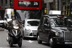 Vehicles drive in central London on Wednesday.
