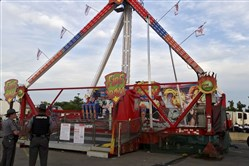 Authorities stand near the Fire Ball amusement ride after the ride malfunctioned injuring several at the Ohio State Fair on Wednesday in Columbus, Ohio.