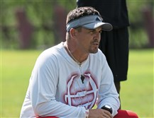 Northgate head coach TJ Wiley squats as he watches a play during a summer practice at Northgate High School on July 25, 2017.