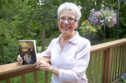 "Emily Rodavich, of Cecil, with her memoir, ""Mystical Interludes."" Ms. Rodavich wrote her memoir to share her mystical experiences with other people that may have had similar encounters."
