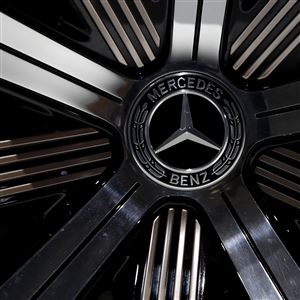 In this Feb. 2, 2017 file photo the logo of Mercedes-Benz E-Class Coupe is photographed prior to the annual balance news conference at the company's headquarters in Stuttgart, Germany.