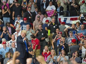 "President Donald Trump waves to the crowd as he leaves the stage after the ""Make America Great Again"" rally Tuesday at the Covelli Centre in Youngstown, Ohio."