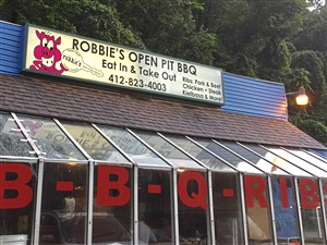 The exterior of Robbie's Super Stuff Super-Licious BBQ on Ardmore Boulevard in Forest Hills.