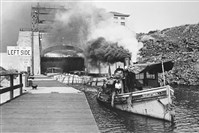 The tugboat Geo E Lattimer departs Lock E17 of the Erie Canal with a tow in September 1921.