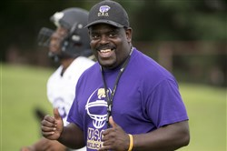 University Prep head coach Lou Berry laughs during a 7-on-7 scrimmage on Wednesday, July 26, 2017 at University Prep High School.