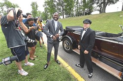 Antonio Brown arrives in a 1931 Rolls Royce Phantom and poses for photos Thursday at Saint Vincents College in Latrobe.