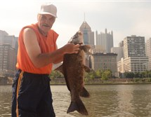 During the July 19 Venture Outdoors' TriAnglers fishing program on the North Shore, John Force of the North Side baited up with a chicken nugget and pulled out a 35-inch smallmouth buffalo, a nongame relative of the common sucker.  SOURCE handout