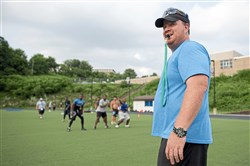 Kevin Murray conducts a preseason practice at Woodland Hills last month. Murray has resigned as head coach.