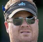 Kevin Murray conducts a preseason football practice in July at Woodland Hills High School.