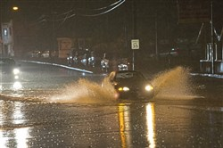Cars attempt to go through water pooling along Rt. 51 Friday, July 28, 2017, south of Edgebrook Ave. in Carrick.