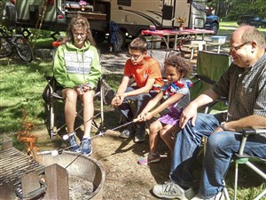 As camp hosts at Raccoon Creek State Park the Malstrom family of Peters lives at the Beaver County campground for weeks at a time. Toasting marshmallows at their campsite, left to right, Joanne, Ricky 13, Noelle 5, and Richard.