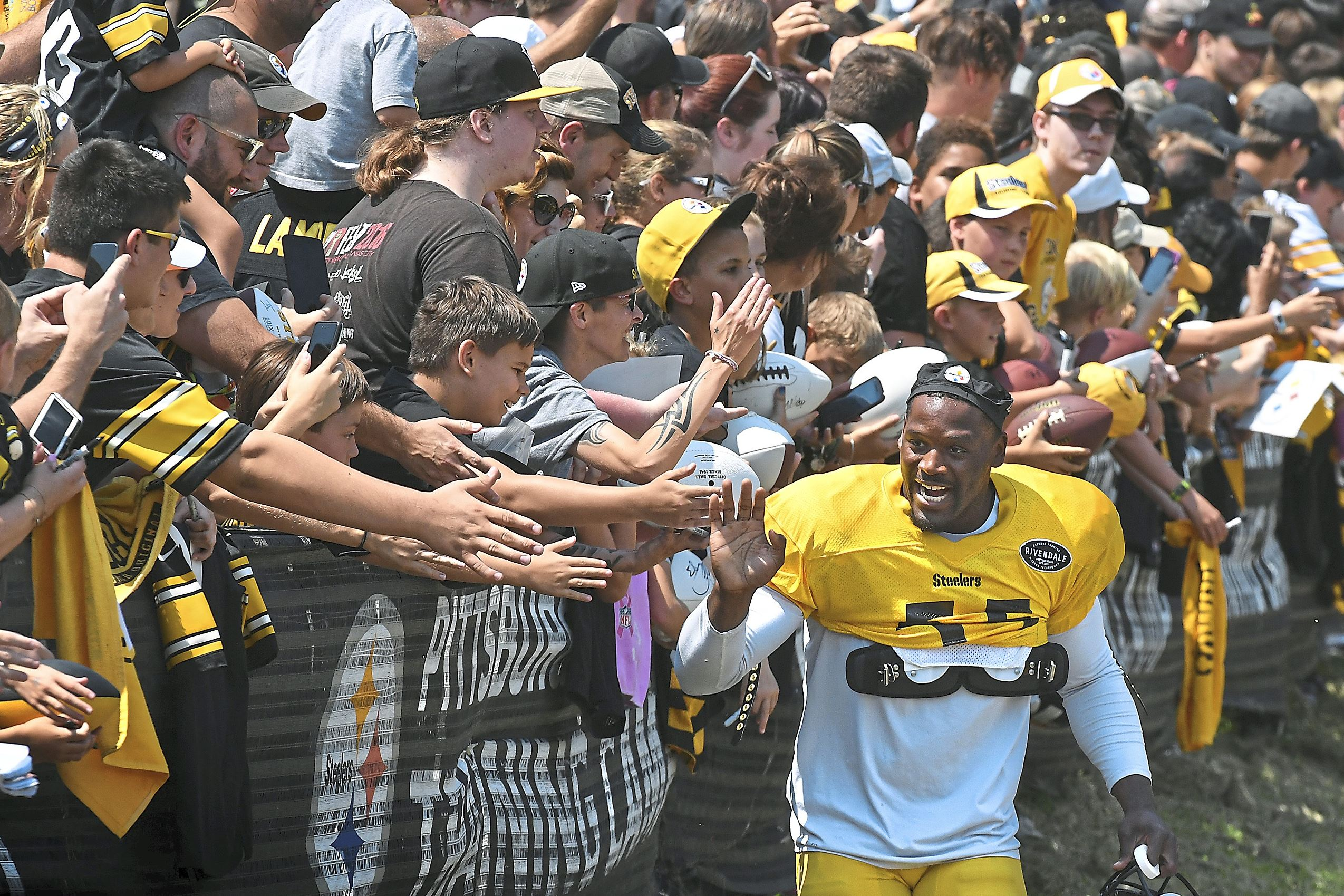 20170730pdSteelersCamp08-2 Arthur Moats high fives fans on his way to afternoon practice at the Pittsburgh Steelers training camp at Saint Vincent College, Latrobe.
