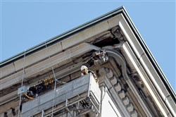 Engineers near the  top of the Frick Building, at the corner of Forbes Ave. and Grant Street, Monday morning July 31, 2017.  A piece of the building fell early Sunday morning and Grant Street was closed.