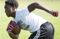 Aliquippa football player Avante McKenzie rushes during a preseason practice on Monday, July 31, 2017 at Aliquippa High School.