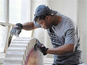 Herbert Walker (cq) from Homewood puts the finishing touches on a project at the Trade Institute of Pittsburgh in Homewood Tuesday, August 1, 2017. (Pam Panchak/Post-Gazette)