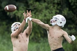 Greensburg Central Catholic's Bryce Kurpiel knocks a pass out of the hands of Max Pisula during a preseason practice on Tuesday, Aug. 1, 2017 at Greensburg Central Catholic High School.