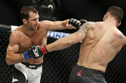 Luke Rockhold, left, fights Chris Weidman in a middleweight  championship mixed martial arts bout at UFC 194 in Las Vegas in 2015.