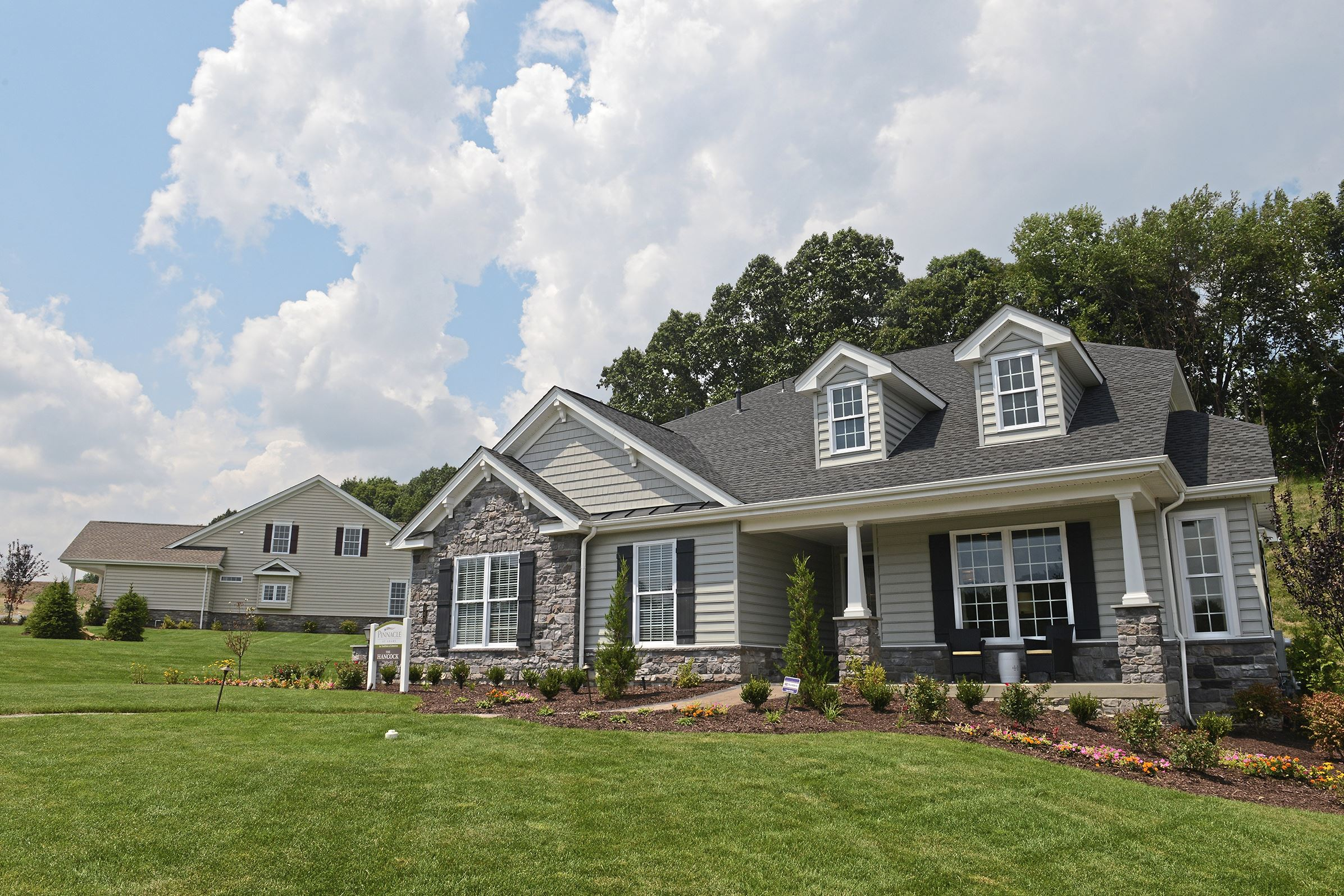 """20170802lf-House01 The exterior of a model home at Pinnacle at Adams in Adams Township is a 55-plus housing community by """"Traditions of America""""."""