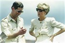 In this April 23, 1991, file photo, Britain's Prince Charles and Princess Diana laugh together during their visit to an iron ore mine near Carajas, Brazil.