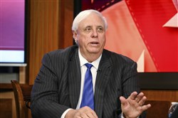 In this March 22, 2017 file photo, West Virginia Gov. Jim Justice speaks during a town hall meeting, at WSAZ's studio in Huntington, W. Va.