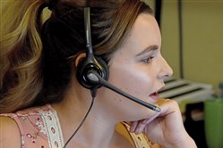 Hanna Forrester, a resource navigator, works with a caller on the 2-1-1 referral service in Butler.