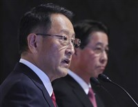 Toyota Motor Corp. President Akio Toyoda, left, and Mazda Motor Corp. President Masamichi Kogai answer a question during a press conference in Tokyo Friday.