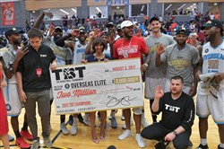 Overseas Elite, including Schenley alumni D.J. Kennedy, DeJuan Blair and DeAndre Kane, celebrates its $2 million The Basketball Tournament win Thursday in Baltimore.