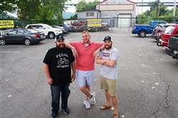 From left brothers Shawn, Tony and Matt Lang stand where the future Pittsburgh Food Truck Park will be along the Riverfront Trail in Millvale.
