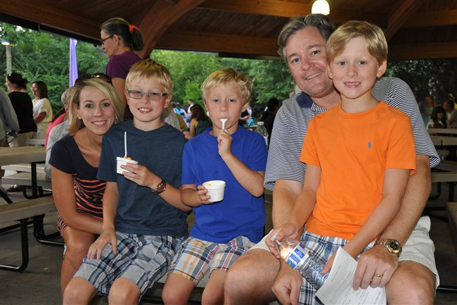Attendees enjoy ice cream at last year's Pressley Ridge Ice Cream Fundae. This year's event is set for 6 p.m. Sunday, Aug. 13, at Pittsburgh Zoo & PPG Aquarium and will feature Graeter's ice cream samples, live entertainment, face painting and children's activities to benefit Pressley Ridge's programs for at-risk children and adults.