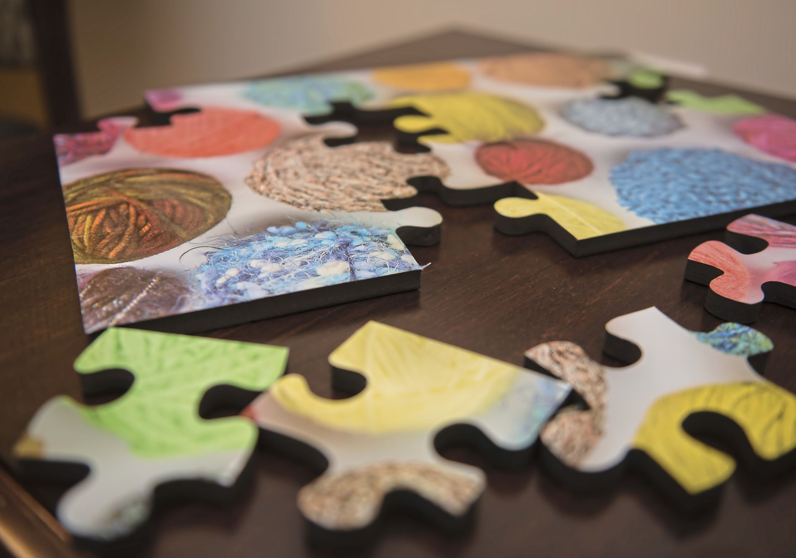 20170803hnAhava-6 A puzzle laid out for residents' use at the AHAVA Memory Care Residence at The Jewish Association on Aging.