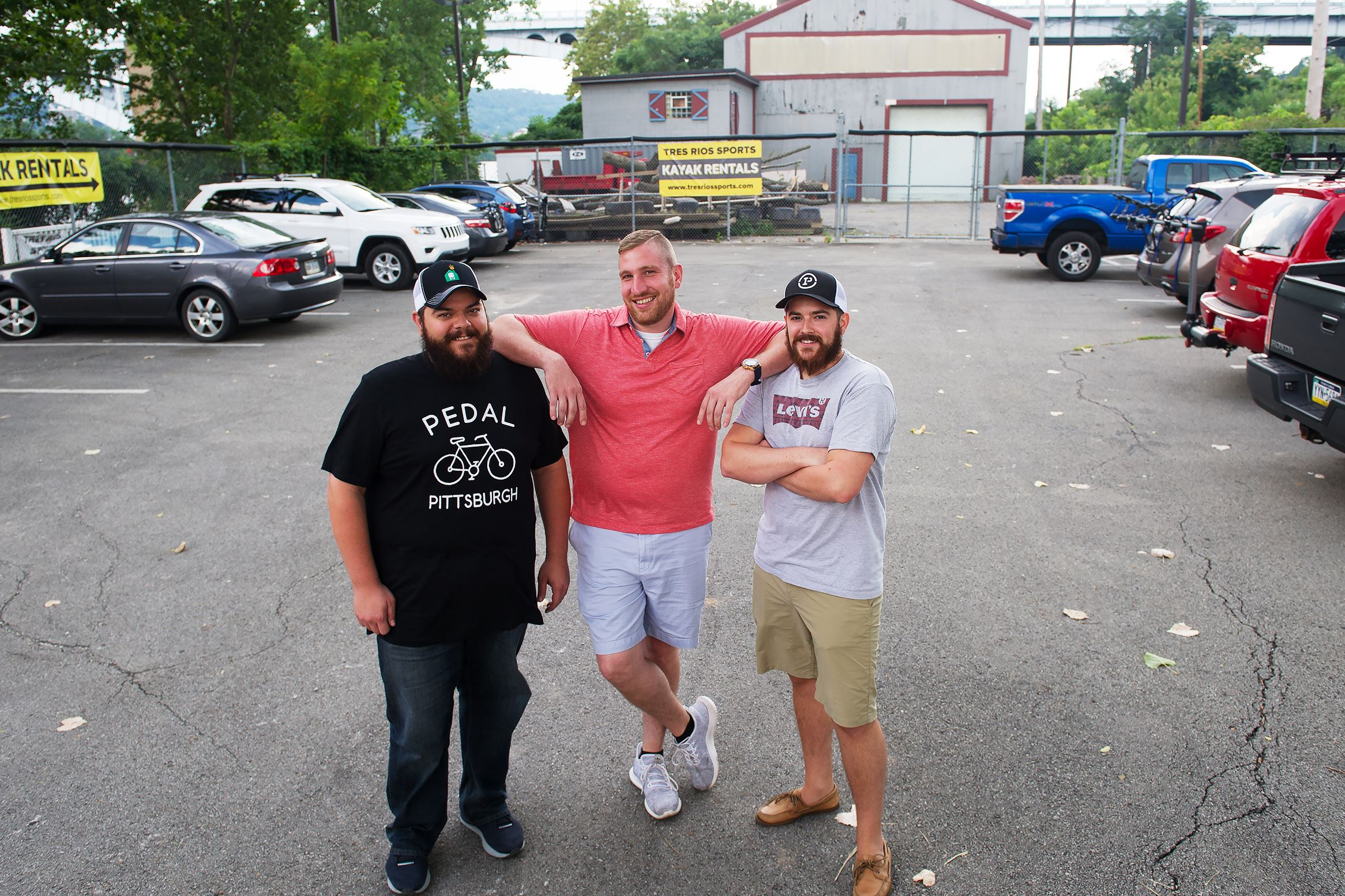 20170802rldFoodTruckPark01 From left brothers Shawn, Tony and Matt Lang stand where the future Pittsburgh Food Truck Park will be along the Riverfront Trail in Millvale.