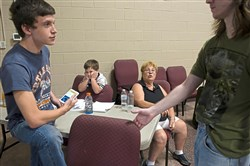 Barb Lehman, second from right, with her grandchildren from left Gunner Lehman, 15, Wade Norris, 5, and Hunter Lehman, 18 , wait to find out about housing accommodations after being evacuated from their home Friday.