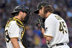 Pirates catcher Francisco Cervelli talks with starting pitcher Gerrit Cole during a game against the Padres Aug. 5.