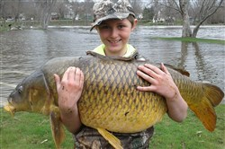 Chase Stokes, then 10, holding a giant carp, weighing 33.25 pounds, in Ferrisburgh, Vt.