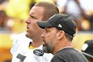 Steelers quarterback Ben Roethlisberger talks with offensive coordinator Todd Haley during practice August 6 at Heinz Field.