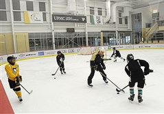 Penguins skills coach Ty Hennes works with young skaters at UPMC Lemieux Sports Complex in Cranberry Township.