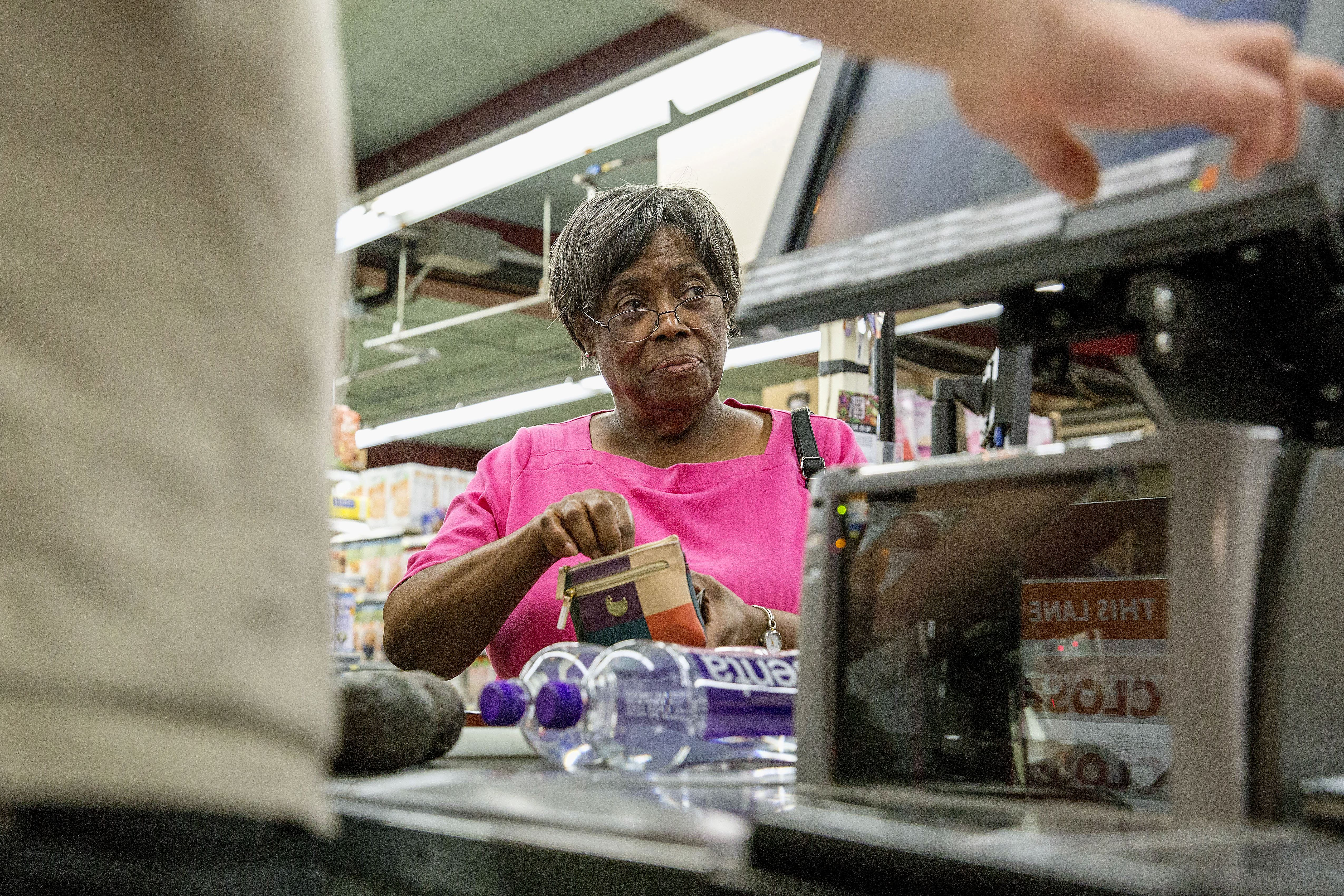 20170802acFoodCo-Op01.jpg Marian Lewis of Verona buys avocados and bottles of water at the East End Food Co-op in Point Breeze.