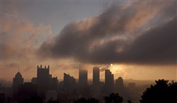 Fog rises over the Pittsburgh skyline in this view from Grandview Avenue on Mt. Washington.