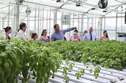 Chris Filling, greenhouse manager at Delaware Valley University, leads guests from the Pennsylvania Department of Agriculture on a 2016 greenhouse tour to educate the public about hydroponics and aquaponics.
