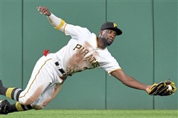 The Pirates' Andrew McCutchen dives to pull in a ball hit by the Tigers' Mikie Mahtook in the fifth inning Monday at PNC Park.