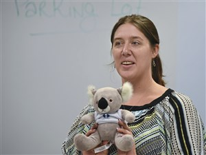 Carissa Monico holds the koala mascot for the program on Mental Health First Aid at the Community College of Allegheny County, South Campus. ALGEE is an acronym for the five steps of the MHFA action plan.