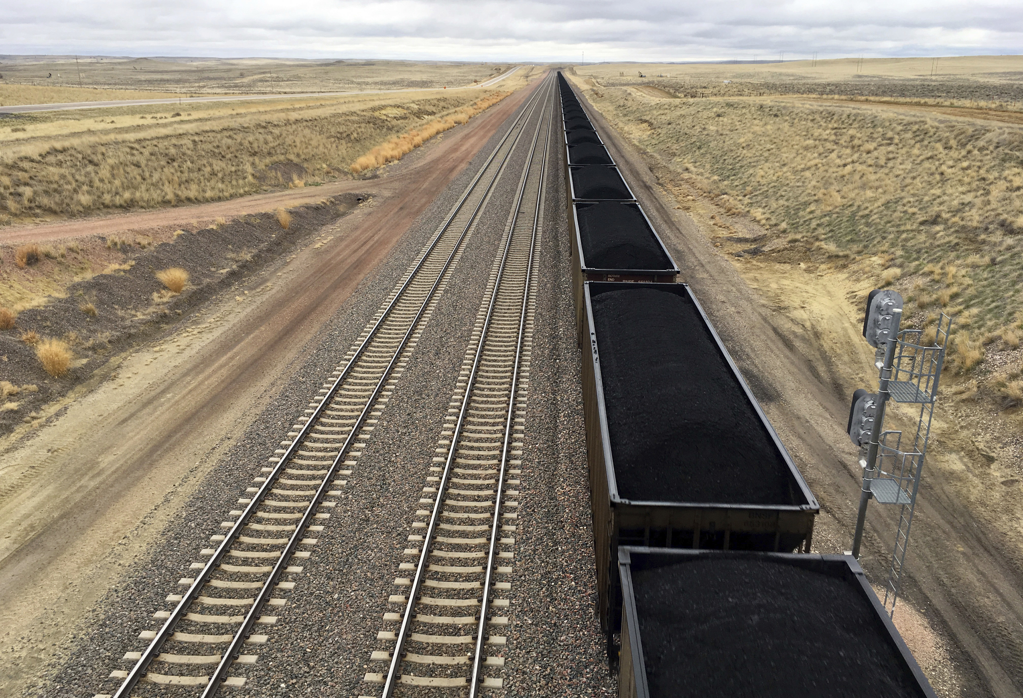 Trump Coal Royalties A train near hauls coal mined from Wyoming's Powder River Basin near Bill, Wyo. The Interior Department has scrapped an Obama-era rule aimed at ensuring that coal companies don't shortchange taxpayers on huge volumes of coal extracted from public lands, primarily in the West. (AP Photo/Mead Gruver, File)