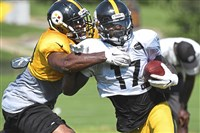 Eli Rogers right, breaks away from Vince Williams in practice recently at Saint Vincent College in Latrobe. Rogers, who played in the slot last season, is trying to find his place in a crowded room this season.