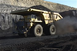 In this Nov. 15, 2016, file photo, a haul truck with a 250-ton capacity carries coal from the Spring Creek strip mine near Decker, Mont.