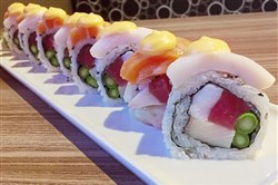 The McKnight Roll with tuna, octopus, yellow tail and asparagus, topped with a spicy mayonnaise and salmon and white tuna at McKnight Kitchen in Ross.