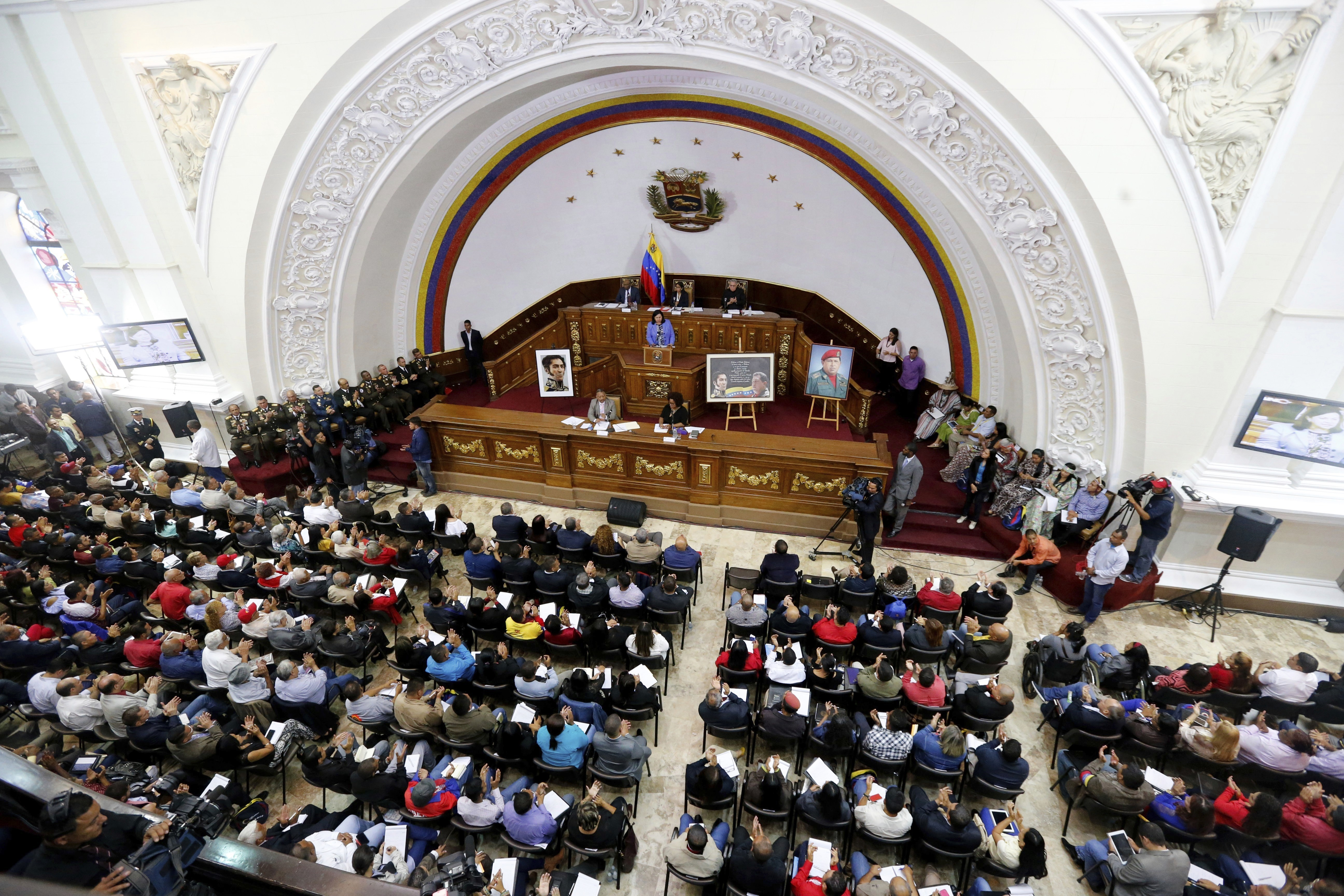 APTOPIX Venezuela Political Crisis Constitutional Assembly delegate Carmen Melendez speaks from the podium during a session in Caracas, Venezuela, Tuesday, Aug. 8, 2017. The government-backed assembly that is recasting Venezuela's political system filed into the stately domed chamber where congress normally meets. In two previous sessions, the 545-member assembly met in an adjacent, smaller building. (AP Photo/Ariana Cubillos)