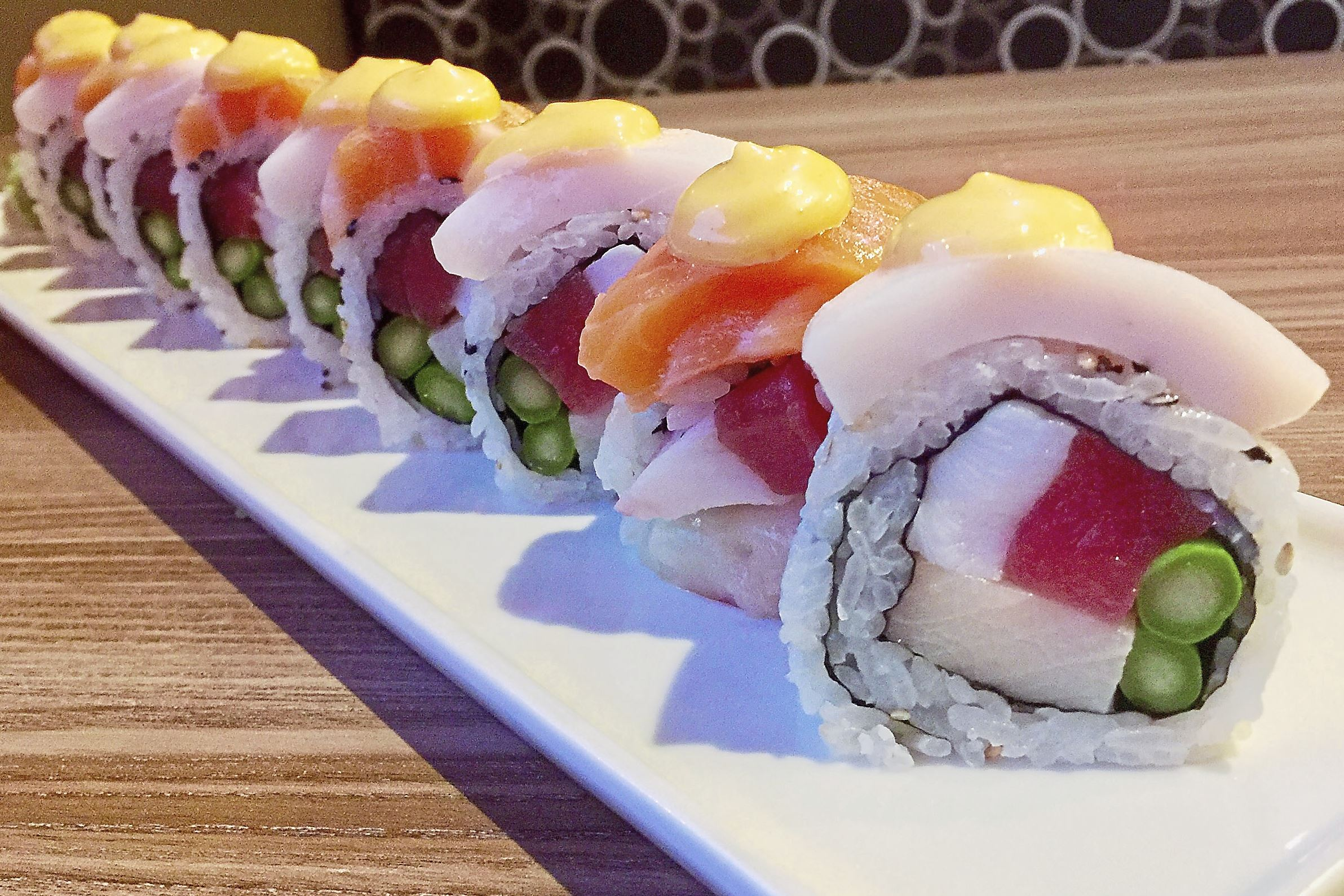 munch mcknight 2-1 The McKnight Roll with tuna, octopus, yellow tail and asparagus, topped with a spicy mayonnaise and salmon and white tuna at McKnight Kitchen in Ross.