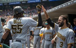 Pirates rookie Josh Bell high-fives teammate Sean Rodriguez after hitting a two-run home run Thursday against the Detroit Tigers.