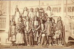Little Plume (back row, far left), Little Chief (last row, second from left), Horse (front row, second from right) and other Northern Arapaho children and two Shoshone children posed for this photo after their arrival at the Carlisle Indian Industrial School., circa 1881.